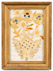 Small framed needlework flower in a silk pocket