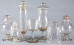 Group of candy and apothecary display show jars