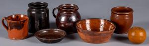 Seven pieces of Pennsylvania redware, 19th c.