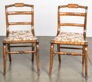 Pair of classical tiger maple sabre leg chairs