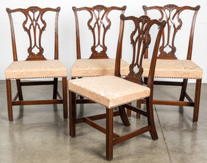 Four George III carved mahogany dining chairs