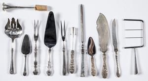 Sterling silver handled serving utensils.